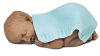 bébé en pâte à sucre à peau foncée