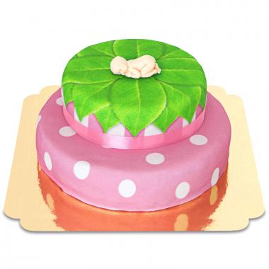 Bébé sur gâteau à deux étages rose